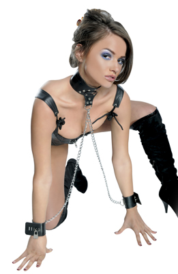 Keep your lovers hands at bay at all times with this Leather Collar and Cuff Set. This versatile leather restraint set allows your subject to move freely enough to perform simple tasks, yet it is a constant reminder that they are bound and at your mercy when they cannot move their arms in a full range of motion. The comfortable leather cuffs easily adjust to fit most sizes and securely stay fastened with lock and key, while the cuffs connect to the adjustable collars O-ring with high-strength metal chains. The O-ring on the collar can also be used to attach a leash for sexy master and servant play. With your lover restrained in this position, you can just imagine the possibilities!  Kit Includes: 1-Collar, 2-Wrist Cuffs, 2-Keyable Locks and 1-Satin Love Mask  Measurements: Collar is 13.25 to 16.5 inches in circumference; Cuffs are 6.5 to 8.25 inches in circumference and Chains are 21 inches in length.  Material: Leather  Color: Black and Silver/Chrome