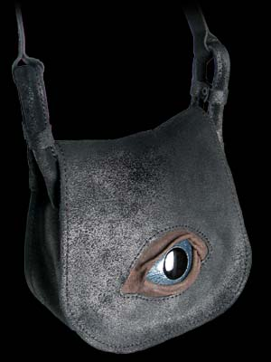 "In the protection of the all-seeing eye of the gods! An eerily realistic enamelled metal and hand crafted leather eye, unflinchingly peers from the front flap of this stylish shoulder bag. Hand made of vintage-style black leather with adjustable strap; Approx. dimensions: 19.5cm (7¾"") wide X 17.5cm (6¾"") high X 7cm (2¾"") deep."